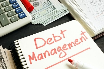 how does a debt management plan work